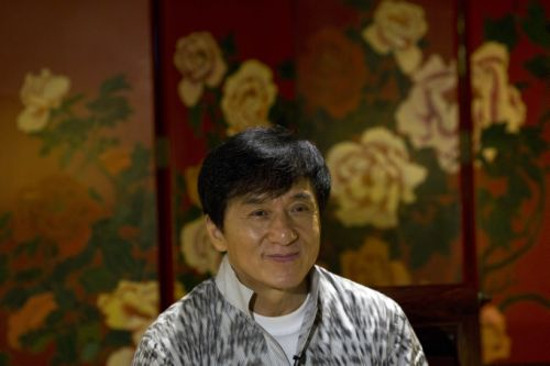 Action star Jackie Chan speaks during an interview in Beijing, Monday, Aug. 3, 2015. Chan said Monday that he wants to work with his son Jaycee on a movie and an album as they mend their relationship after Jaycee was jailed on a drug charge. (AP Photo/Ng Han Guan)